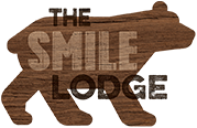 The Smile Lodge Logo
